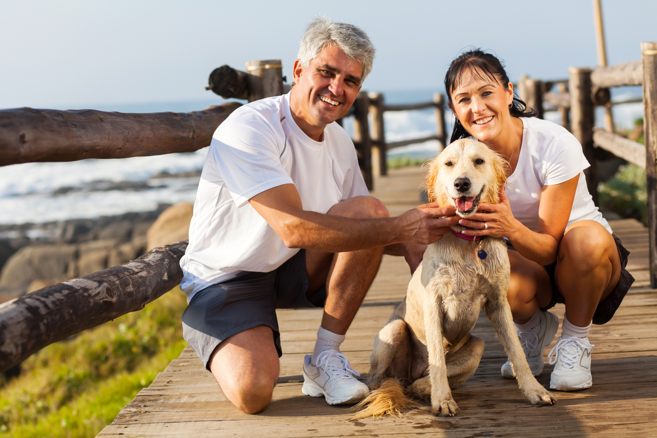 Over 40 couple with their dog and wondering how long to date before marriage.