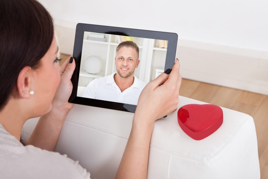 Woman on a virtual date hoping this man is open to love.