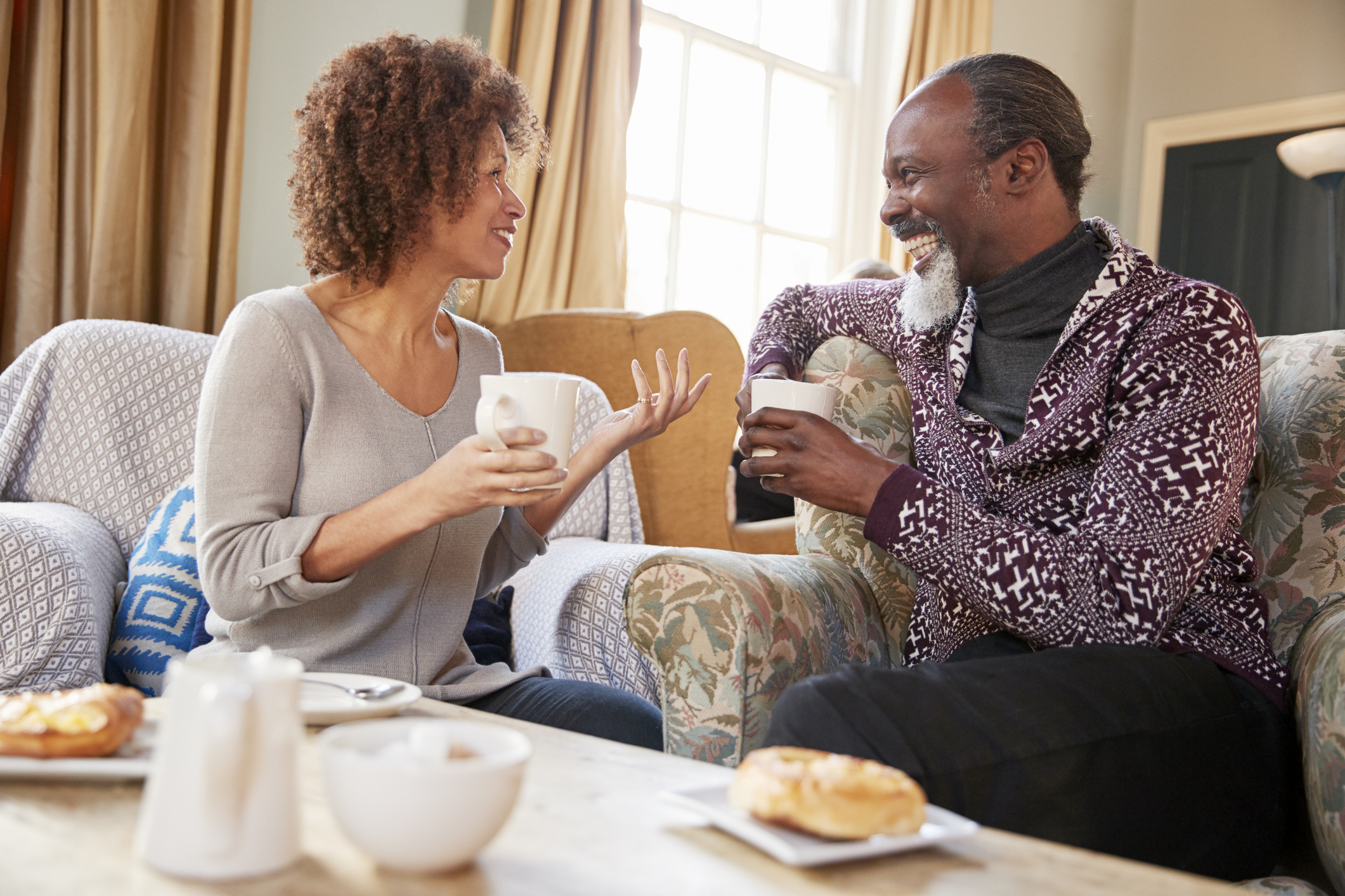 Couple enjoying a coffee date because they're both ready to start dating again.