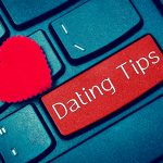 "Computer keyboard with ""Dating Tips"" covering the enter key."