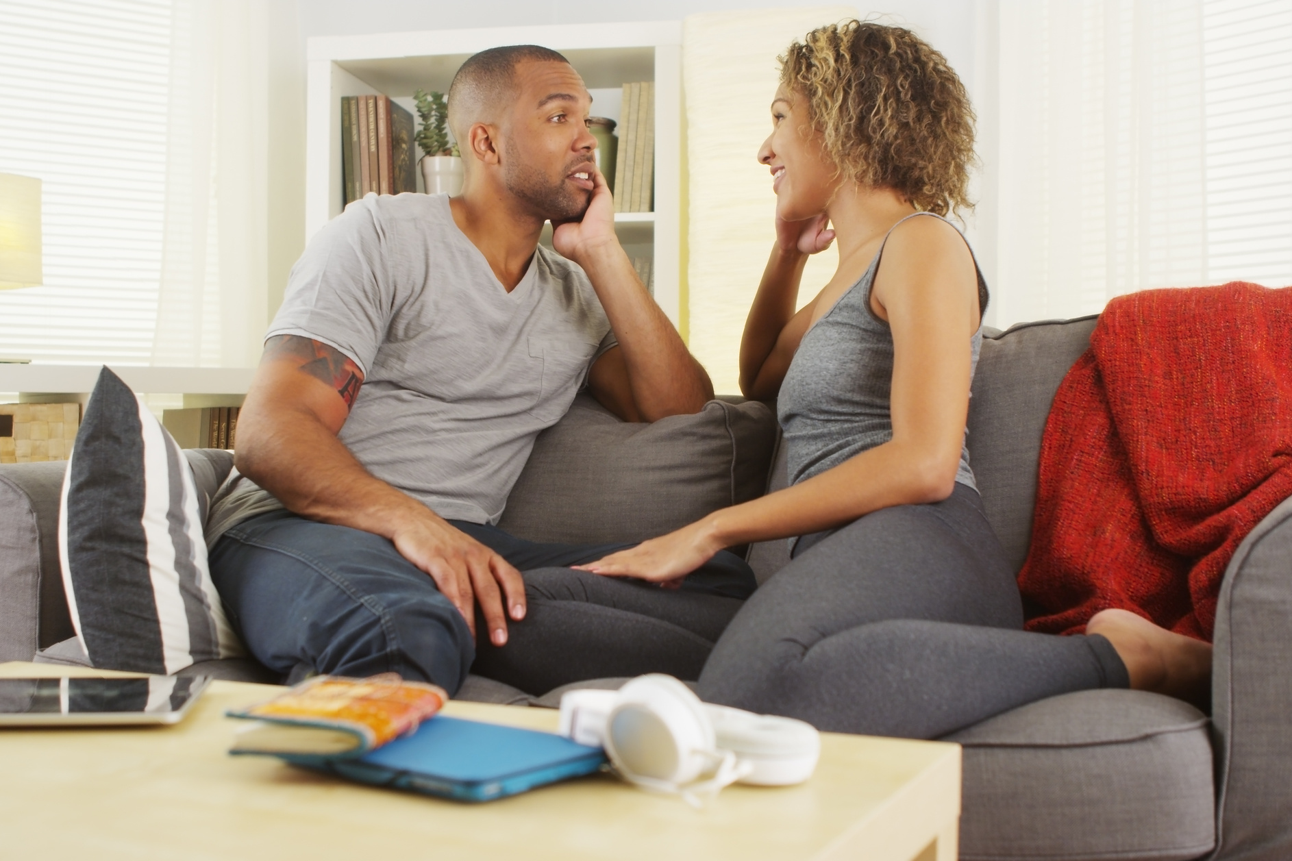 Couple sitting on a couch having a conversation